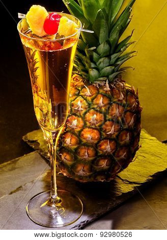 Champagne  cocktail with cherry and slice of pineapple in highball glass . Cocktail card 61