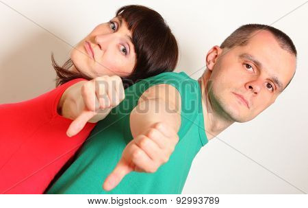 Unhappy Woman And Man Showing Thumbs Down