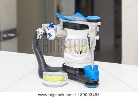 Technical shots of model on a dental prothetic laboratory poster