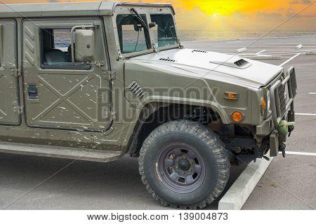 Humvee jeep on sunrise backgrund Military transportation.