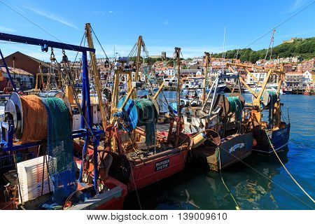 SCARBOROUGH ENGLAND - JULY 16: Fishing trawler boats moored up in the harbour. In Scarborough North Yorkshire England. On 16th July 2016.