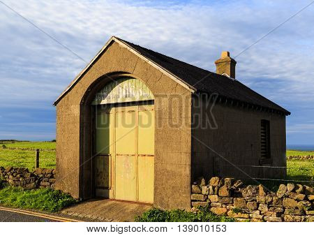 WHITBY ENGLAND - JULY 16: An attractive stone outbuilding near farmland. In Whitby North Yorkshire England. On 16th July 2016.