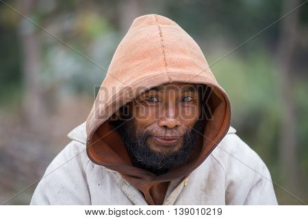 MRAUK-U MYANMAR - JANUARY 27 2016: Unknown portrait beggar man outdoors Burma