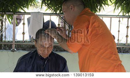 Monk Shave Hair Of Man Who Will Become Buddhism Monk In Ordination Ceremony
