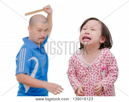 Little Asian girl crying while her dad hitting by ruler