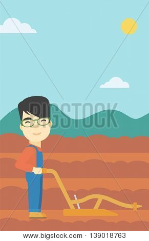 An asian farmer using a plough on the background of plowed agricultural field. Farmer working with a plough. Vector flat design illustration. Vertical layout.