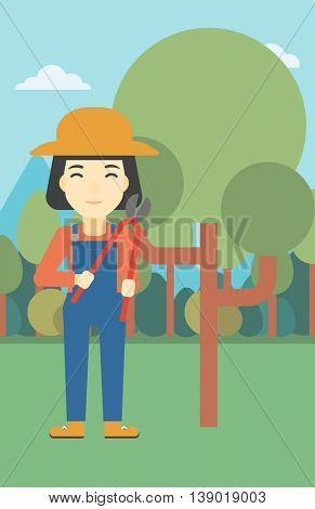 An asian female farmer working with a pruner in the garden. Young woman pruning branch. Gardener trimming branches in garden. Vector flat design illustration. Vertical layout.