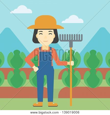 An asian female farmer holding a rake. Friendly farmer standing on the background of cabbage field. Vector flat design illustration. Square layout.