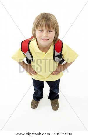 Studio Portrait of Smiling Boy Holding Ruck Sack