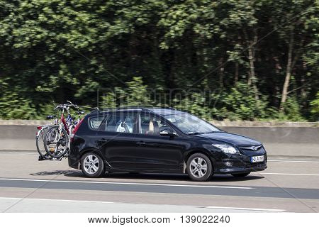 FRANKFURT GERMANY - JULY 12 2016: Hyundai i30 Tourer family car on the highway in Germany