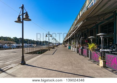 Sydney Australia - Jul 3 2016: Historic Finger wharf in Woolloomooloo bay. It is the longest timbered-piled wharf in the world and is famous for its restaurants and bars