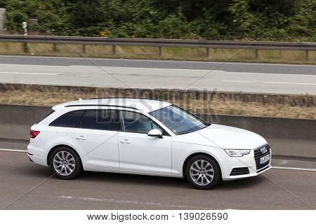 FRANKFURT GERMANY - JULY 12 2016: White Audi A6 Estate on the highway in Germany