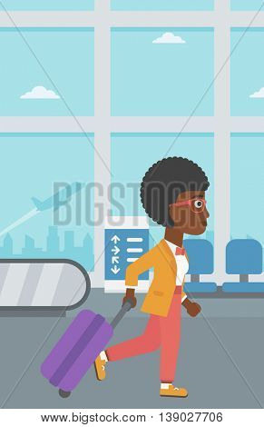 An african-american young woman with a suitcase walking at the airport. Vector flat design illustration. Vertical layout.