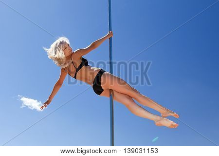 Blonde In Bathing Suit On Pole For Dancing