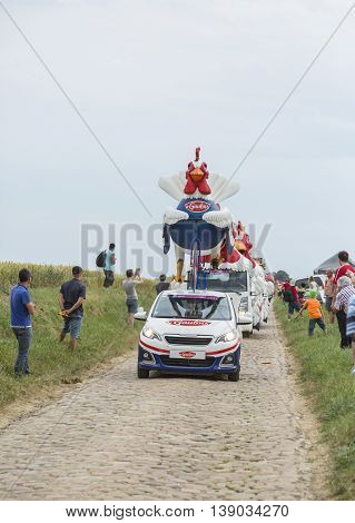 Quievy, France - July 07 2015: Le Gaulois Caravan during the passing of the Publicity Caravan on a cobblestone road in the stage 4 of Le Tour de France on July 7 2015 in Quievy France. Le Gaulois is an important French producer of poultry meat products
