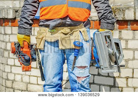 Construction worker with tools in summer day