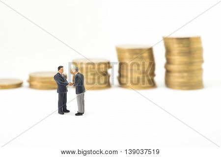Successive business concept. Businessmen checking hand in front of growth coin stack stair.