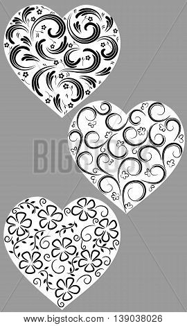 Three hearts from curls on a homogeneous background