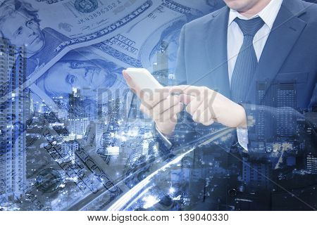 Double Exposure Of Business Man Working With Smart Phone And City Center Of Business With Bank Dolla