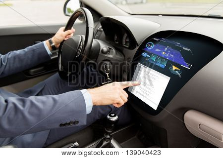 transport, navigation, business trip, modern technology and people concept - close up of man driving car with gps navigator and coding on board computer screen