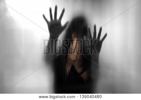 Double Exposure Of Horror Woman Behind Matte Glass In Black Blurred Hand And Body Figure And Woman C