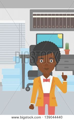 An african-american young business woman standing in the office and pointing up with her forefinger. Business idea concept. Vector flat design illustration. Vertical layout.
