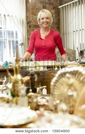Female antique shop proprietor