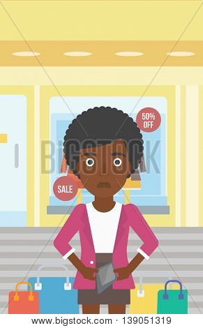 An african-american woman showing her epmty wallet on the background of showcase of a store. Vector flat design illustration. Vertical layout.