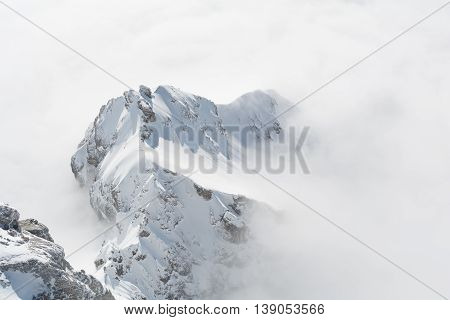 sunny mountain of Dachstein Mountain stands out in the mist carpet - austria