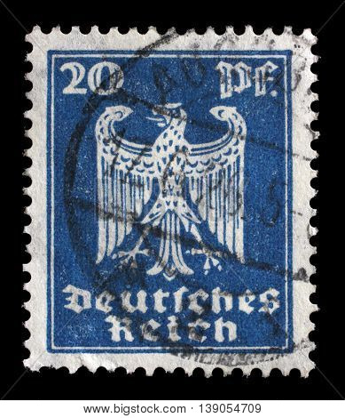 GERMANY - CIRCA 1924: A stamp printed in Germany shows the Eagle, coat of arms of Germany, circa 1924.