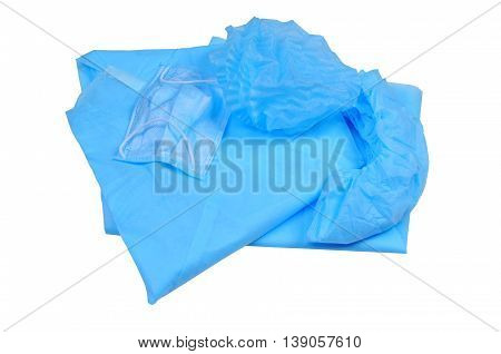 set of overalls for the hospital - a diaper gown shoe covers cap and mask. isolated on white background. view from above