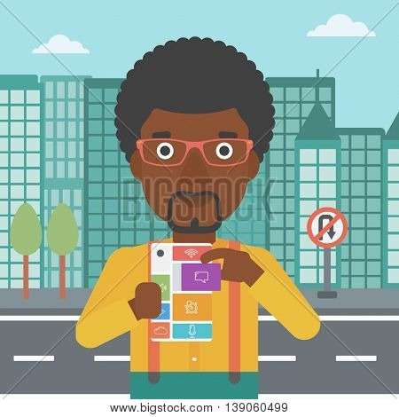 An african-american man holding modular phone. Young man with modular phone on a city background. Man using modular phone. Vector flat design illustration. Square layout.