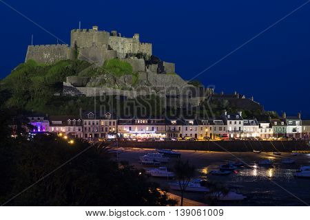 The town of Gorey with Mont Orgueil Castle at night, Jersey, UK