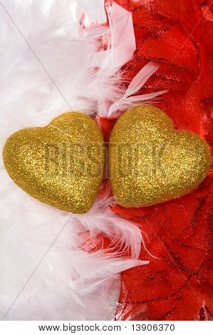 Two Hearts Over White And Red Feathers Background