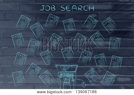 Laptop User Surrounded By Lots Of Resumes