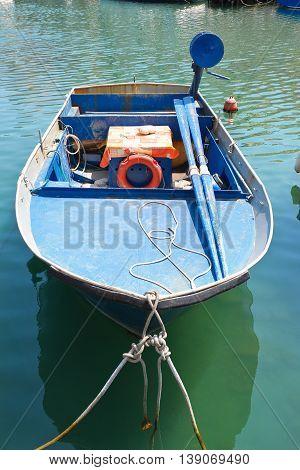 Boat anchored at the seaport of Giovinazzo. Puglia. Italy.