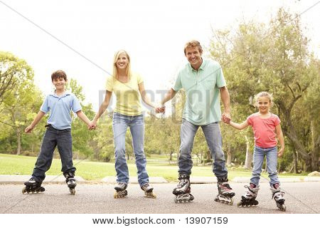 Family Wearing In Line Skates In Park