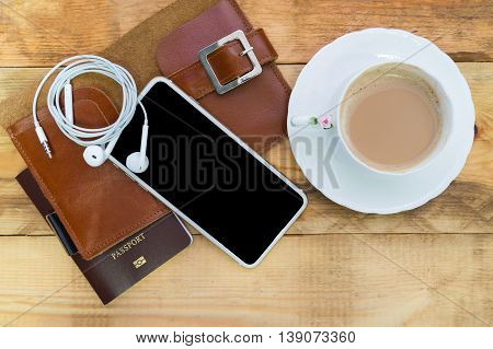 Preparation for travel Top view of smartphone coffee with milk passport. Holidays and tourism concept