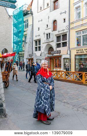 Tallinn Estonia - October 18 2015: The girl in the national costume about a famous local restaurant Olde Hansa in Tallinn.