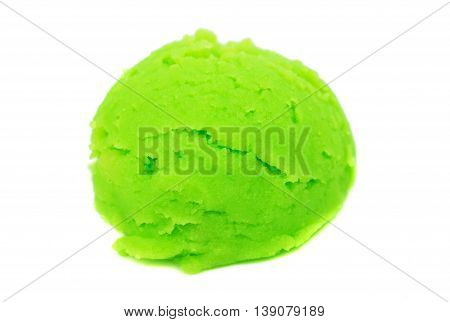 Scoop of pistachio ice cream from top on white background with clipping path