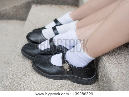 Side of Asian Thai girls schoolgirl student feet with black leather shoes as a school uniform.