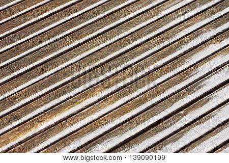 Textured illustration of diagonal shiny brownish lines