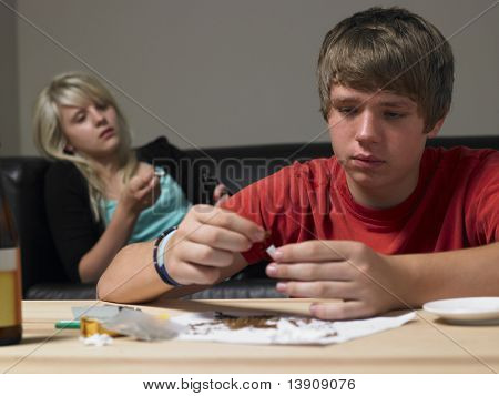 Teenage Couple Taking Drugs At Home