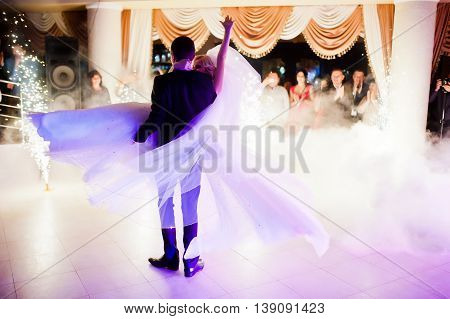Amazing First Wedding Dance Of Newlyweds On Low Pink Light And Heavy Smoke With Fireworks