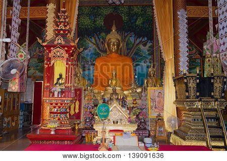 CHIANG RAI, THAILAND - JANUARY 12, 2014: The altar of the temple Wat Sri Kird. Religious landmark  of the city Chiang Rai, Thailand