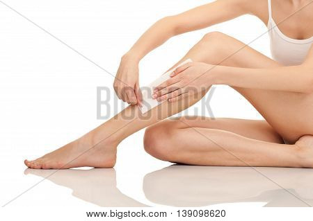 Depilation female legs waxing herself isolated on white background