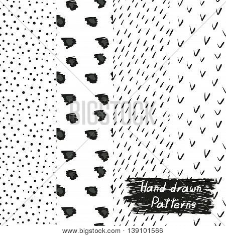 Set of hand drawn seamless patterns in black and white. Collection of doodle vector backgrounds.