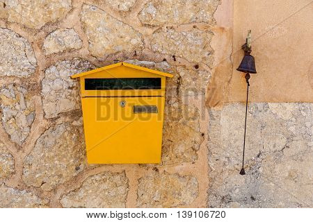 Postbox and a bell set in a stone wall, Postbox and a bell