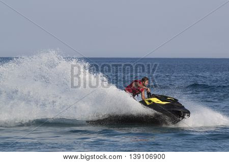 Unidentified Turkish Man Turns Sharply Over The Waves Of The Mediterranean Sea On Jet Ski