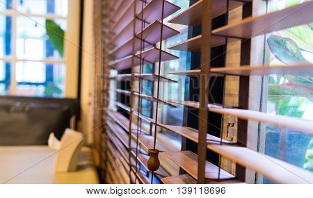 Wooden curtain shutter in home windows light